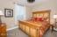Bedroom 3 with Unique Custom Ceiling Fan, 2 Tone Designer Paint, Horizontal Blinds & Drapes, Door to Jack & Jill Bath & Walk-In Closet.