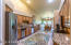 Generous kitchen with granite counter, warm maple cabinets, and one year old appliances