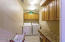 Laundry room with folding counter and ample cabinet storage.