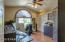 Hardwood floors and plantation shutters in this bedroom/office.