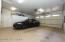 2 car garage w/side door leading to the 3rd bay. Would make a great workshop!