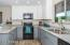 """New kitchen cabinetry, 42"""" upper cabinetry with soft close, lazy susan, granite counters, stainless steel sink and faucet"""
