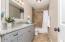 "New 6' x 36"" high vanity with granite counters, plumbing fixtures, flooring, tub/shower, hardware & decorator mirror"