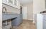 Tons of storage in new laundry room with large stainless steel sink, new 50 gallon high efficiency electric water heater, washer & dryer included