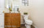 Half bath located on first floor is perfect for when you have guests.