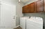 Inside Laundry with Nice Upper Cabinetry with Utility Closet & Direct Garage Access.