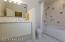 High ceilings in guest bath create an open spacious feel