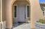 Covered Front Door Entrance, 8' Door with Accent Windows.