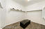 Spacious Master Bedroom Walk-In Closet with Brand New Plank Tile Flooring.