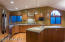 Island includes pendant lighting, Italian convection bake oven and a prep sink