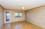 Large master bedroom with access to the upper level deck