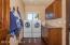 Nice Laundry room with nice folding cabinet.