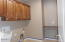 Laundry Room W/ Sink, Cabinets, Folding Counter