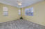 with Large Mountain View Windows + Horizontal Blinds, Lighted Ceiling Fan, Carpet Flooring, Walk In Closet & 2 Tone Paint.