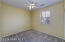 with Carpet Flooring, Lighted Ceiling Fan, Sunny Window with Front Yard View, Horizontal Blinds, 2 Tone Paint & Sliding Door Closet.