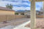 Covered & Open Patios, Easy Care Rear Yard with Bradshaw Mountain Views & Block Wall Fencing with Iron Gate.
