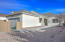 with Easy Care Landscaping, Covered & Open Extended Patio + Concrete Walkway.