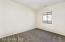 with Carpet Flooring, Sliding Door Closet, Sunny Window & 2 Tone Paint.
