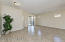 Nice 18' Tiled Great Room with Designer 2 Tone Paint, Sunny Sliding Glass Door, Accent Windows, Ceiling Light & Ceiling Fan Outlet.