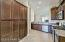 """with Staggered Hardwood Cabinetry, Pantry Cabinets, Recessed Lighting, BRAND NEW Stainless Appliances + Gas Stove, Sunny Window, 18"""" Tiled Flooring, Pullout Sprayer Faucet, Beautiful Granite Counters & Granite Dining Bar."""