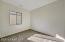with 2 Tone Paint, Sunny Window, Sliding Door Closet & Carpet Flooring.