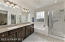 """Granite Vanity Counter, Dual Sinks, Oval Bath, Clear Glass Enclosed Shower, Heat Lamp, Sunny Views Window w/Vertical Blinds, Recessed Lighting, Hardwood Cabinetry w/ Pulls & 18"""" Tiled Flooring."""
