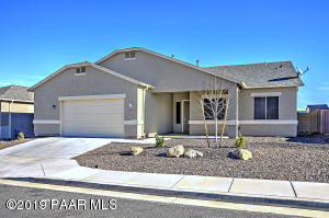 with Painted Stucco Finish, Covered Front Porch, 2.5 Car Garage Door, Garage Coach Lights & Easy Care Pro-Landscaping.