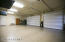 Oversized 3 car garage with built in storage and overhead racks.