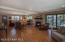 Large main living area with gas fireplace for those cool evenings. And access to covered deck for outdoor relaxation