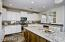 Gorgeous Granite Kitchen w/Lrg Granite Island, S/S Gas Stove, Microwave, Lrg Pantry, Built In Wine Cooler, Pendant Lighting and Recessed Lighting.