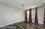Dining Area w/Designer Light and Laminate Wood Flooring