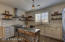 Updated kitchen to today's standards. Shaker cabs, custom open shelving, recently installed granite, appliances and more!