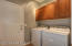 Good size laundry room with cabinet storage