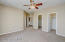 Master Bedroom with Lighted Ceiling Fan & Dual Walk in Closets.