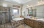 Gorgeous Tiled Master Bath with Separate Garden Tub and Glass Enclosed Shower