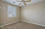 with Walk In Closet, Lighted Ceiling Fan & Front Yard View Window with Plantation Shutters.