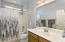 with Tall Executive Height Marble Counter, Tub /Shower Combo & Tiled Flooring,