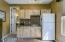 Granite Kitchenette Counter, Back-splash, Stainless Sink, Birch Cabinetry, Carpet, Tile Flooring & Custom Lighting,