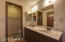 The master bath has ample closet and counter space with a walk in shower.