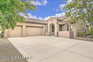 with Large 3 Car Garage, Big Driveway, Shaded Front Coffee Patio, Lush Pro Landscaping & Corner Location.