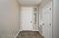 """with 8' Entry Door, Fresh 2 Tone Interior Paint, Coat Closet, Accent Window & 20"""" Floor Tile."""