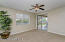 with Lighted Ceiling Fan, Sunny Windows & Sliding Door to Rear Yard, Carpet Flooring & New 2 Tone Paint.