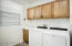 """with Deep Utility Sink, Sunny Window, Utility Closet, Oak Cabinetry w/Handles, 20"""" Tiled Flooring, Fresh Paint, Washer & Dryer."""