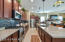 Wonderful upgraded kitchen with beautiful tile back splash and huge island with quartz
