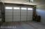 Windows in garage door provide natural light in garage.