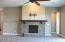 Great Room gas fireplace; mounting bracket above for Flat Screen TV. Door to right is entry to Master Suite.
