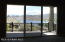 Huge Slider in Great Room leads to the large covered deck. Views of Watson Lake and The Dells.