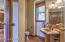 3/4 bathroom with separate shower room and laundry shoot.