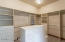Walk in master closet with organization. Master suite also features a laundry area not pictured.