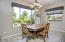 Nice & Sunny Tiled Dining Area with Sliding Glass Door to Covered Rear Patio.
